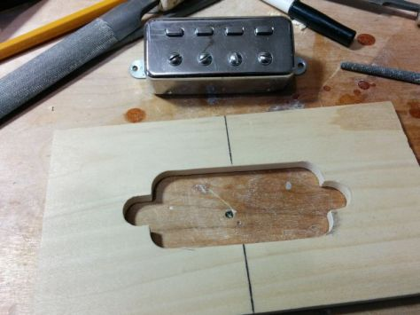 For the pickups, I had to make my own routing template. I just traced a pickup onto a piece of wood, and then Icut it out.