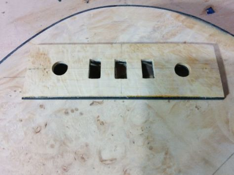 Here I'm working out the electronics cover plate. I cut and laminated some scrap burl over black plastic sheet.